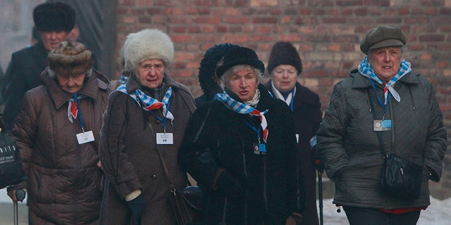 Holocaust survivors commemorate the people killed by the Nazis at the former Auschwitz Germany Nazi death camp in Oswiecim, Poland, Friday, Jan. 27, 2017, on the International Holocaust Remembrance Day that marks the liberation of the Auschwitz Nazi death camp on Jan. 27, 1945. (AP Photo/Czarek Sokolowski)