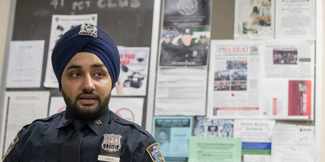 In this Tuesday, Jan. 24, 2017 photo, New York City police officer Mandeep Singh speaks during an interview with The Associated Press at the 41st Precinct in the Bronx borough of New York.