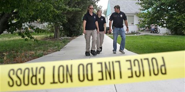 Police officials rope off a home during an investigation after a 12-year-old girl was found dead Friday, July 17, 2015, in West Valley City, Utah. The search for the missing 12-year-old girl is now being investigated as a homicide after West Valley City police discovered the girl's body in a horse pasture. Police Chief Lee Russo says the girl's mother approached two officers at a convenience store near their home around 1:30 a.m. Friday,July 17, 2015. She told officers her daughter had been missing since midnight. (AP Photo/Rick Bowmer)