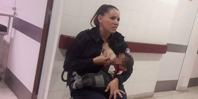 Celeste Ayala was captured breastfeeding a malnourished child.