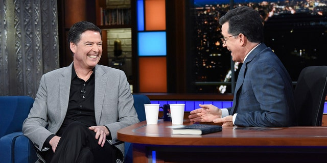 """This image released by CBS shows former FBI Director James Comey, left, with host Stephen Colbert on """"The Late Show with Stephen Colbert."""""""