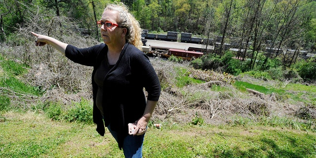 April 12, 2018: Mayor Heather Hall discusses the nearby train that was loaded with tons of sewage sludge that is stinking up her community of Parrish, Ala.