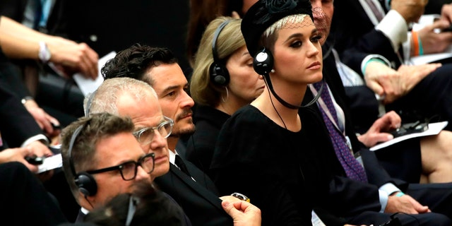 Orlando Bloom and Katy Perry sit in the Paul VI Hall in Vatican City.