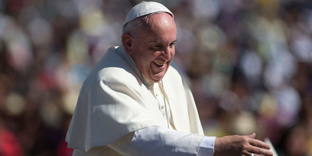 Pope Francis waves from his popemobile as he arrives in San Cristobal de las Casas, Mexico, Monday, Feb. 15, 2016. Francis is celebrating Mexico's Indians on Monday with a visit to Chiapas state, a center of indigenous culture, where he will preside over a Mass in three native languages thanks to a new Vatican decree approving their use in liturgy. The visit is also aimed at boosting the faith in the least Catholic state in Mexico. (AP Photo/Eduardo Verdugo)