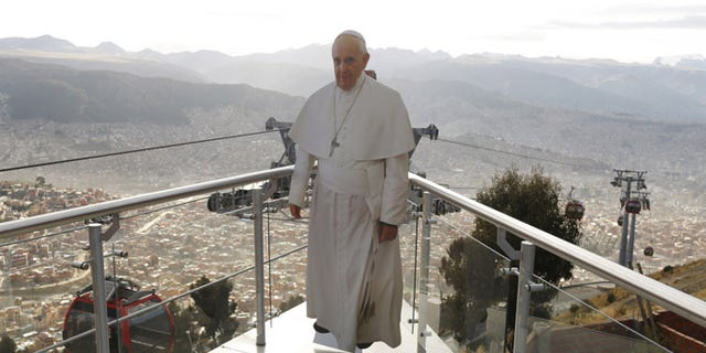 """Pope Francis called """"unfettered capitalism"""" the """"dung of the devil"""" during his trip to South America. (The Associated Press)"""