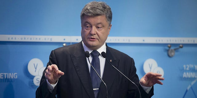 Ukrainian President Petro Poroshenko delivers a speech as he attends the 12th Yalta European Strategy Annual Meeting in Kiev, Ukraine, September 11, 2015. REUTERS/Ukrainian Presidential Press Service/Pool  ATTENTION EDITORS - THIS IMAGE HAS BEEN SUPPLIED BY A THIRD PARTY. IT IS DISTRIBUTED, EXACTLY AS RECEIVED BY REUTERS, AS A SERVICE TO CLIENTS. FOR EDITORIAL USE ONLY. NOT FOR SALE FOR MARKETING OR ADVERTISING CAMPAIGNS.   - GF10000201361