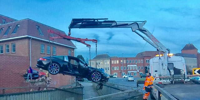 Emergency services needed to use a crane to remove the vehicle.