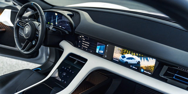 The four-passenger vehicle features a high-tech interior design.