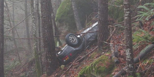 The Porsche had been hard to spot because of the position of the vehicle at the bottom of the cliff.