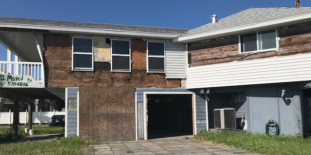 Candidates say continuity of representation is important in a district still recovering from Hurricane Harvey. This is one of dozens of damaged homes in Port Aransas, Texas.