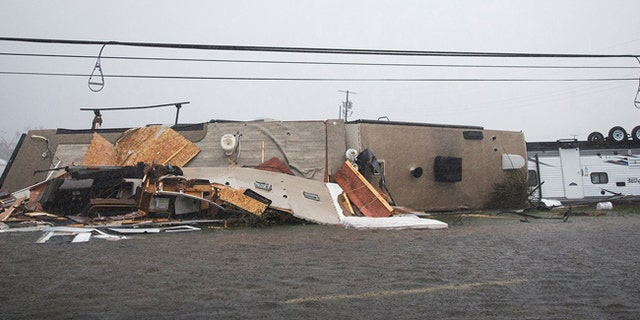 A trailer home sits on its side after Hurricane Harvey ripped through in Rockport, Texas, on Sat., Aug. 26, 2017.