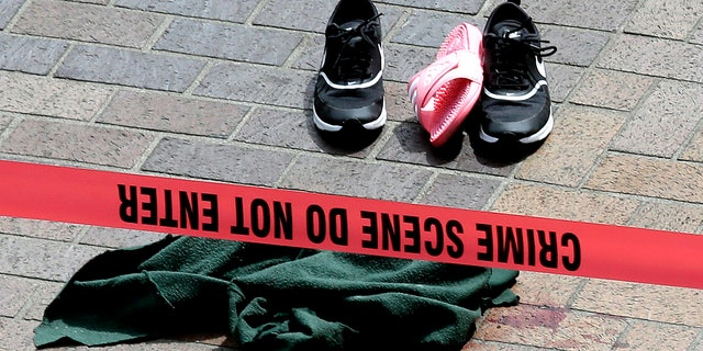 Clothing is strewn on the sidewalk at a scene where pedestrians were hit by a motorist in Portland, Ore., Friday.