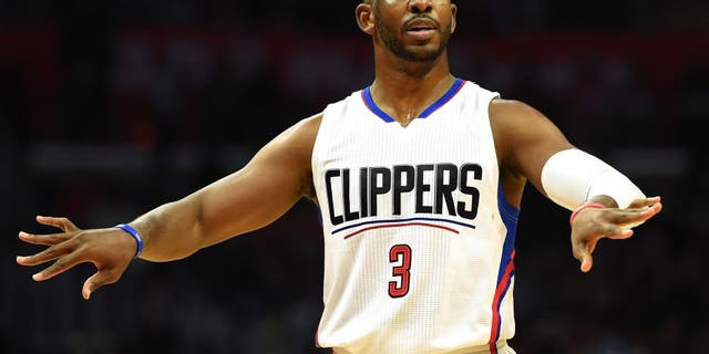 LOS ANGELES, CA - NOVEMBER 09: Chris Paul #3 of the Los Angeles Clippers motions to his teammates during a 111-80 win over the Portland Trail Blazers at Staples Center on November 9, 2016 in Los Angeles, California. NOTE TO USER: User expressly acknowledges and agrees that, by downloading and or using this photograph, User is consenting to the terms and conditions of the Getty Images License Agreement. (Photo by Harry How/Getty Images)