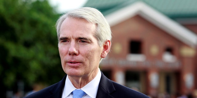 Sen. Rob Portman, R-Ohio, addresses the media outside the art center before a funeral service for Otto Warmbier, who died after his release from North Korea, at Wyoming High School in Wyoming, Ohio, U.S. June 22, 2017.  REUTERS/John Sommers II - RTS18721