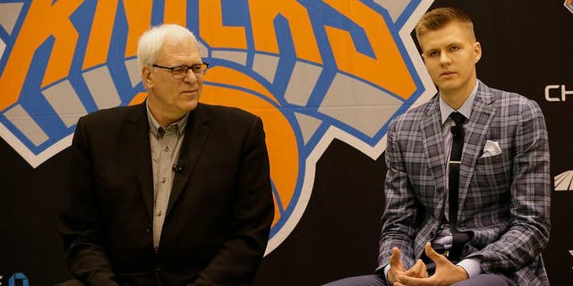 Former New York Knicks executive Phil Jackson, left, and first-round draft pick Kristaps Porzingis address the media at the Madison Square Garden Training Facility on June 26, 2015, in Tarrytown, N.Y. Porzingis was traded to the Dallas Mavericks on Jan. 31, 2019. (Getty Images)