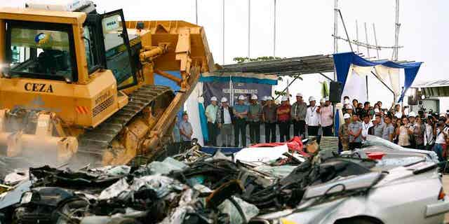 Philippine president Rodrigo Duterte watched over the destruction of 14 illegally imported cars.