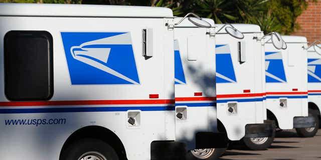 Nov. 13, 2013: U.S. postal service trucks sit parked at the post office.