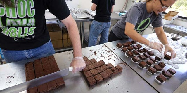 Sept. 26, 2014:  In this file photo, smaller-dose pot-infused brownies are divided and packaged at The Growing Kitchen, in Boulder, Colo. Colorado health officials want to ban many edible forms of marijuana, including brownies, cookies and most candies, limiting sales of pot-infused food to lozenges and some liquids.