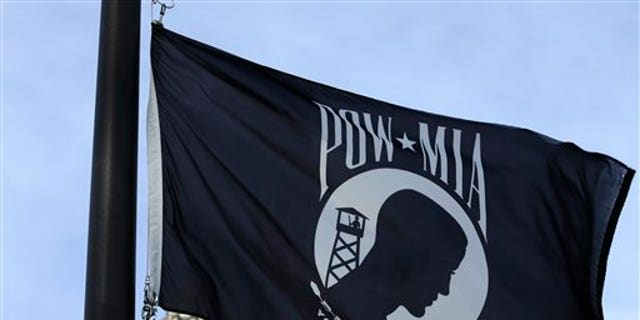 A POW/MIA flag flies Friday, Sept. 20, 2013, in Olympia, Wash., on National POW/MIA Recognition Day.