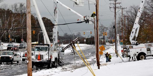 Utility workers fixing power lines in Eatontown NJ after superstorm Sandy and a Nor'easter have a 1-2 punch to the eastern seaboard earlier this month.