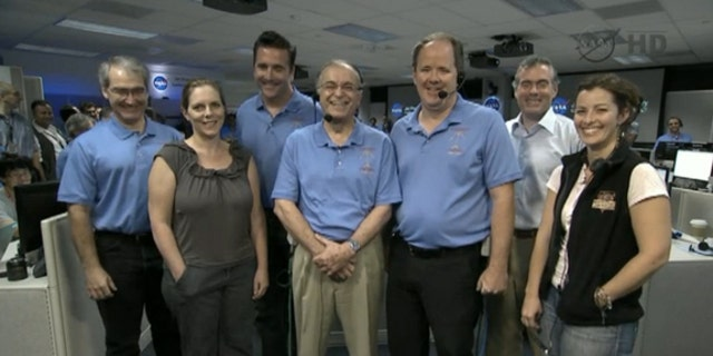 """The team behind NASA's Mars rover Curiosity's Aug. 5 landing take a call from President Barack Obama on Aug. 13, 2012. At center is NASA Jet Propulsion Laboratory director Charles Elachi. Obama called the Mars landing """"mindboggling."""""""