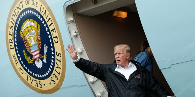U.S. President Donald Trump waves while departing Ellington Field after meeting with flood survivors and volunteers who assisted in relief efforts in the aftermath of Hurricane Harvey, in Houston, Texas, U.S., September 2, 2017. REUTERS/Kevin Lamarque - HP1ED921KVT0C