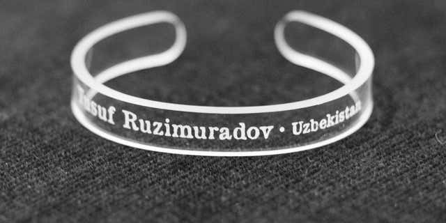 This handout photo provided by the Press Uncuffed Campaign shows a bracelet that University of Maryland journalism students are selling emblazoned with the names of journalists imprisoned around the world.