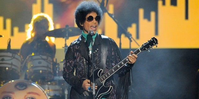 In this May 19, 2013, file photo, Prince performs at the Billboard Music Awards at the MGM Grand Garden Arena in Las Vegas.