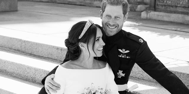 Britain's Prince Harry and Meghan Markle, on the East Terrace of Windsor Castle, Windsor, England, Saturday May 19, 2018.