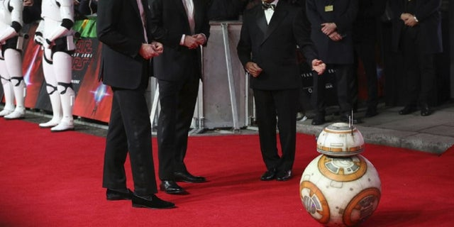 The tuxedo-clad princes walked the red carpet at London's Royal Albert Hall for the film's premiere in London on Tuesday.