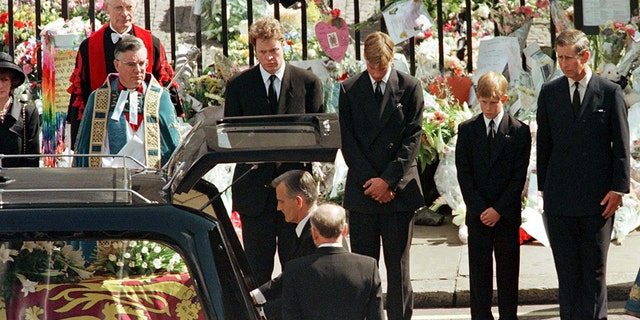 Earl Spencer (2L) Prince William (3L) , Prince Harry and Prince Charles (R) watch as the coffin of Diana, Princess of Wales is placed into a hearse at Westminster Abbey following her funeral service, September 6. Millions of mourners lined the route to pay their respects. - PBEAHUMOWCS