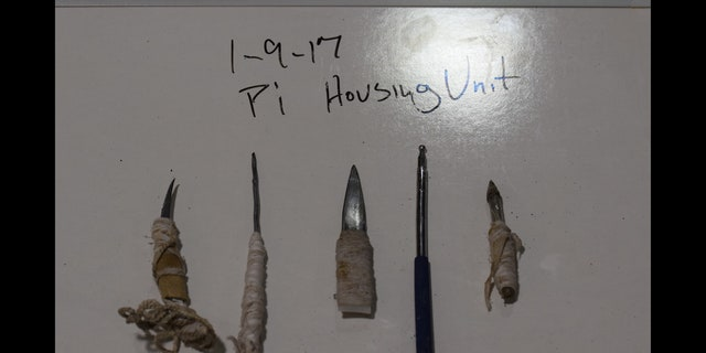Inmates fought with real and makeshift knives, prison officials said.