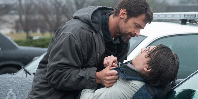 """This image released by Warner Bros. Pictures shows Hugh Jackman, left, and Paul Dano in a scene from """"Prisoners."""""""