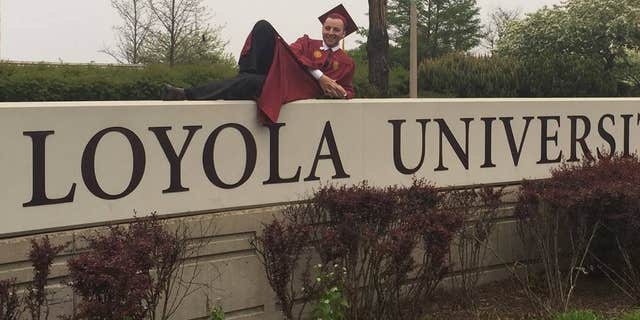 MAy 15, 2016: Andrey Privin after graduating from Loyola University.
