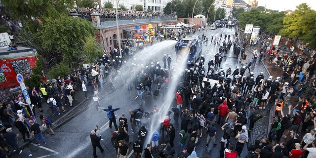 German riot police used water cannons against protesters demonstrating near the G-20 summit in Hamburg, Germany, on Thursday, July 6, 2017.