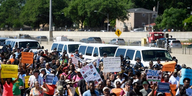 Protesters march on the Dan Ryan Expressway in Chicago. The protesters shut down the expressway in an attempt to increase pressure on public officials to address the gun violence that's claimed hundreds of lives in some of the city's poorest neighborhoods.