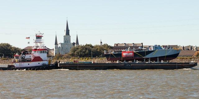 PT-305, atop a barge, heads toward Louisiana's Lake Pontchartrain.