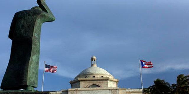 A bronze statue of San Juan Bautista stands in front of Puerto Rico's capitol in San Juan.