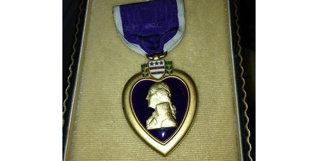 In this photo provided by Donna Gregory is the Purple Heart medal awarded to Pfc. John Farrell Eddington who was killed in action in Italy during World War II.