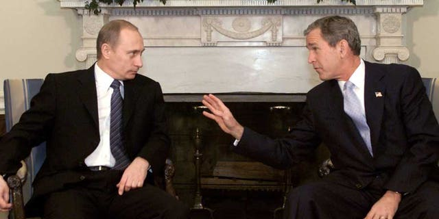 Russian President Vladimir Putin, left, and former President George W. Bush, right, met at the White House in September 2005 and November 2001. This photo shows a meeting in the Oval Office in November 2001.