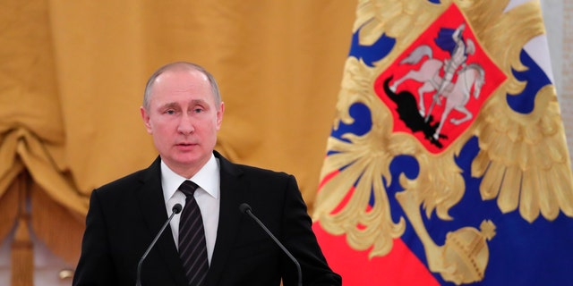 Russian President Vladimir Putin speaks during a New Year reception in the Kremlin in Moscow, Russia, Wednesday, Dec. 28, 2016. (Mikhail Klimentyev/Sputnik, Kremlin Pool Photo via AP)
