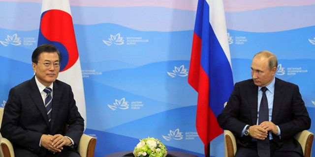 South Korean President Moon Jae-in, left, and Russian President Vladimir Putin meet at the Eastern Economic Forum in Vladivostok, Russia, Sept. 6, 2017.