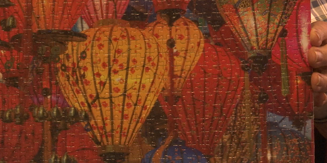 David Butler has solved a variety of different puzzle designs including a scene of lanterns.