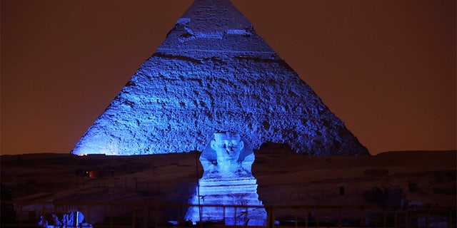 The Sphinx and the historical site of the Giza Pyramids are illuminated with blue light, as part of the celebration of the 70th anniversary of the United Nations in Giza, just outside Cairo, Egypt, in 2015.