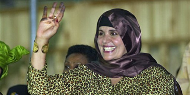 In this Monday, Sept. 1, 2003 file photo, showing Safiya Gadhafi, the wife of Libyan leader Muammar Qaddafi, waves at Libyan soldiers during a military parade at Tripoli's main square.