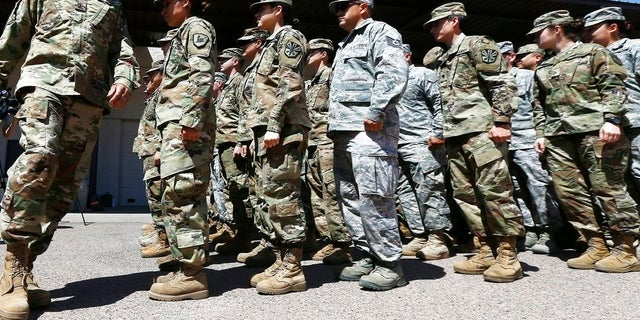Arizona National Guard soldiers line up as they get ready for a visit from Arizona Gov. Doug Ducey prior their deployment to the Mexico border at the Papago Park Military Reservation Monday, April 9, 2018, in Phoenix.