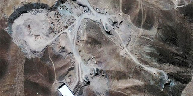 Sept. 26, 2009: This satellite image provided by GeoEye shows a facility inside a mountain outside of Qom, Iran.