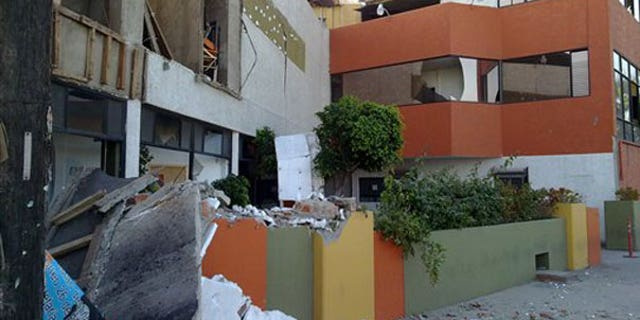 """April 4: Photo provided by Jorge Rivera aka """"cimarron98"""" via Twitter shows structural damage to the Escomex business school building after an earthquake in Mexicali, Mexico. (AP)"""