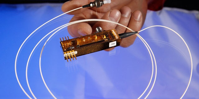 Feb. 14, 2013: Los Alamos National Laboratory completed the first-ever demonstration of securing control data for electric grids using quantum cryptography, with this miniature transmitter.
