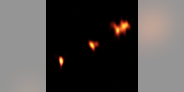 VLBA image of the quasar P352-15 at a distance of nearly 13 billion light-years from Earth. Three main components of the object are seen, with two of them showing further substructure.